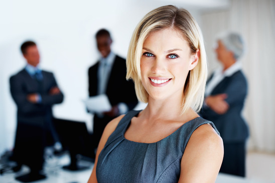 photodune-646835-female-executive-with-team-in-background-xs