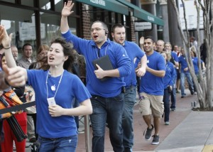Employees run along and cheer the waiting crowd before the opening of the Apple Store on University Drive, Friday, March 16, 2012, for the introduction of the iPad 3. (Ron T. Ennis/Fort Worth Star-Telegram/MCT)